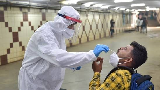 A man is being tested for Covid-19 in India.